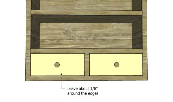 Fitting the drawers inside the openings