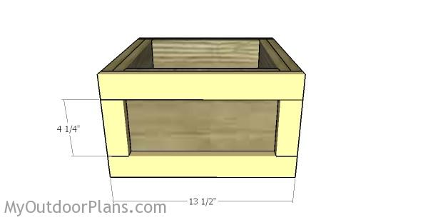 Attaching the trims to the sides of the crate