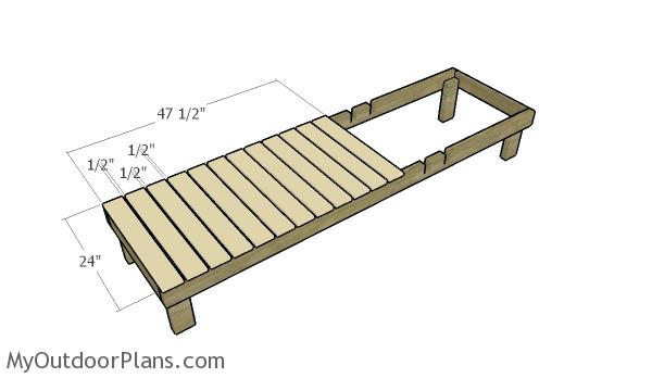 Fitting the slats to the frame of the sun lounger