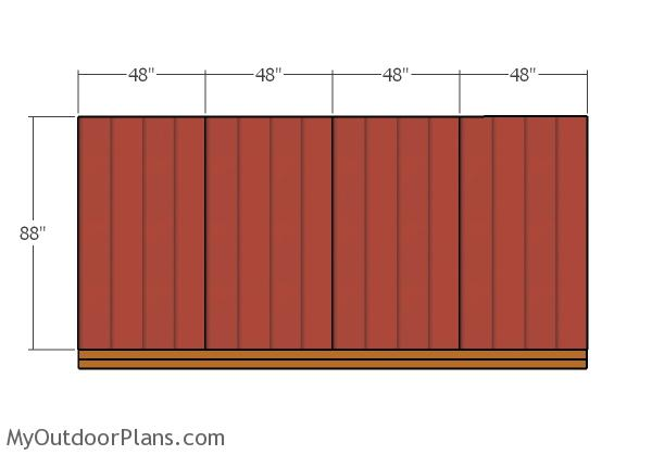 fiting-the-siding-panels-to-the-back-of-the-shed