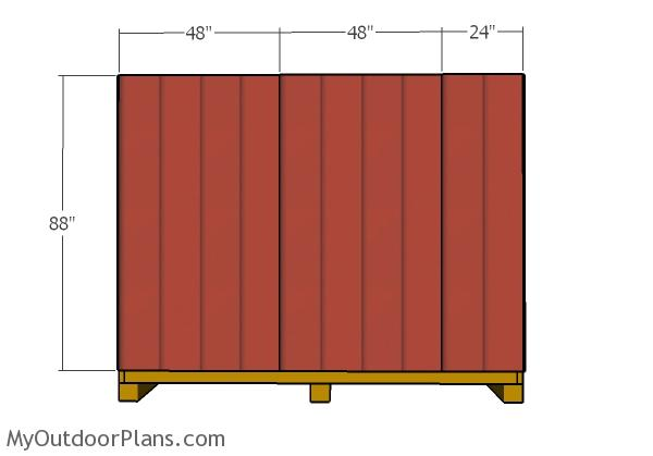 fitting-the-siding-panels-to-the-back-wall