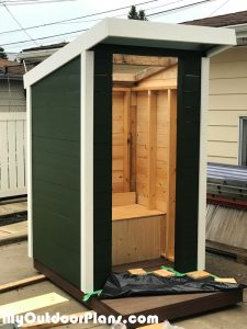 Building-a-wooden-outhouse