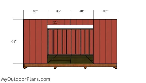Side wall with door siding panels