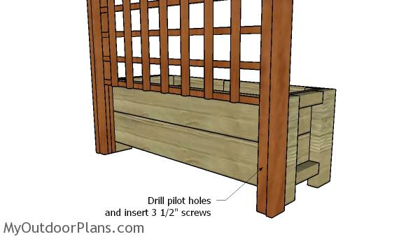 Attaching the trellis to the back of the planter box