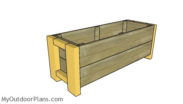 Fitting the legs to the planter box