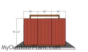 Fitting the siding sheets to the back wall