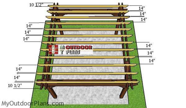 Fitting-the-rafters-to-the-12x14-pergola