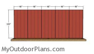 Fitting the back siding sheets - 8x20 run in shed
