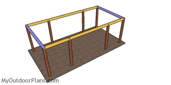 Assembling the top rails for the carport