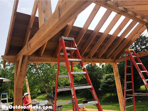Attaching-the-roof-boards-to-the-outdoor-pavilion