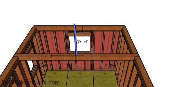 Fitting the kind posts - 12x12 square shed with hip roof