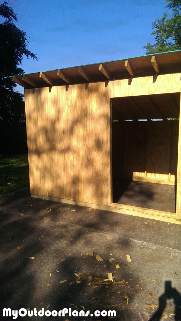 Attaching-the-panels-to-the-exterior-of-the-goat-shelter
