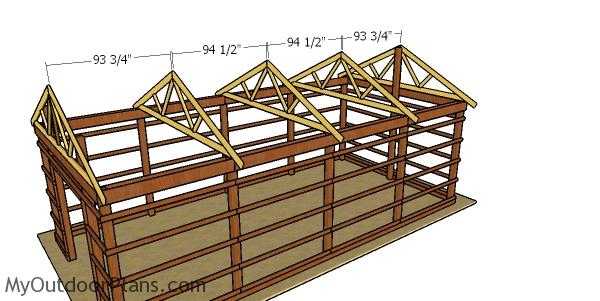 Fitting the trusses to the top of the 16x32 pole barn