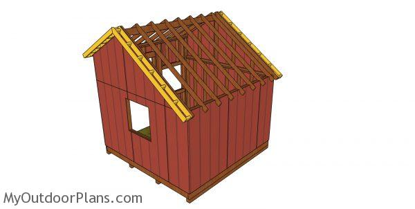 Attaching the overhangs to both sides of the shed