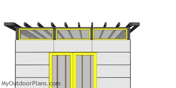 Fitting the top front windows - modern shed