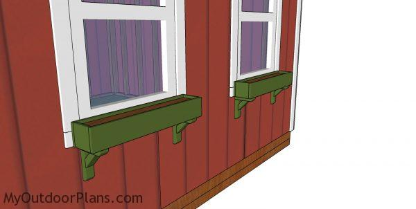 Fitting the window boxes to the sides of the she shed