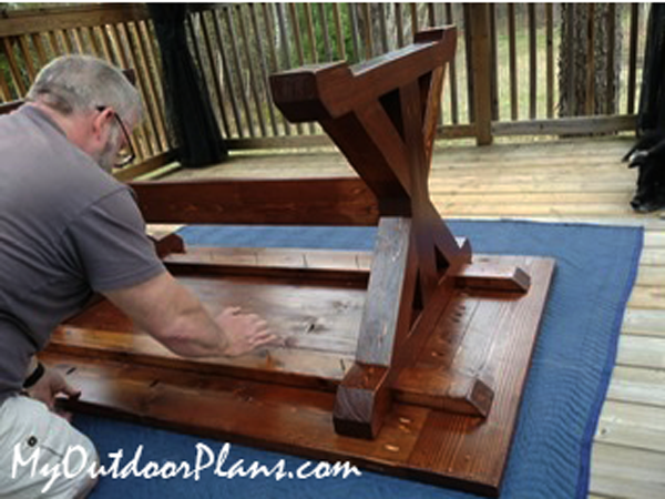 Attaching-the-top-to-the-farmhouse-table-frame