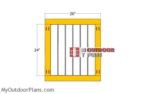 Assembling-the-side-frames-for-the-dog-kennel