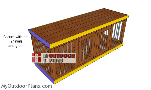 Fitting-the-trims-to-the-wooden-dog-kennel